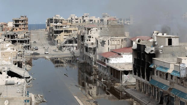 A destroyed street in Sirte, where former Libyan leader Moammar Gadhafi was hiding. Canada is hoping to 'support democratic development' in the new Libya, Foreign Affairs Minister John Baird says.