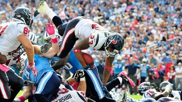 Arian Foster of the Houston Texans dives into the end zone for a touchdown against the Tennessee Titans during play at LP Field on October 23, 2011 in Nashville, Tennessee.