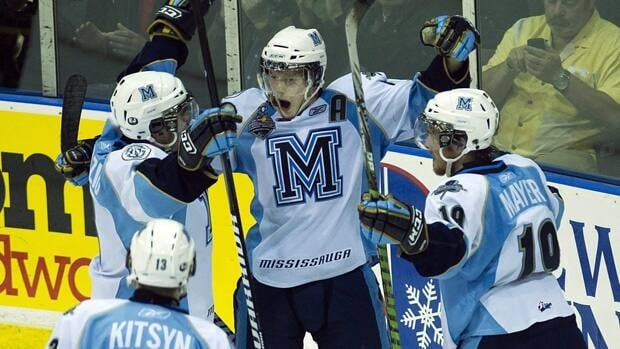 Majors Rob Flick, top centre, celebrates his second-period goal with teammates.