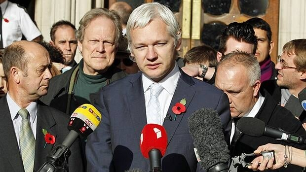 The founder of WikiLeaks Julian Assange, centre, gives a statement to the media after his extradition hearing at the High Court in London on Wednesday. Assange lost his appeal against extradition to Sweden to answer sex crime allegations, but may now take his protracted fight to Britain's highest court.