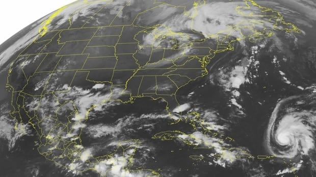 A satellite image taken Friday shows Hurricane Ophelia south of Bermuda, at the bottom right.