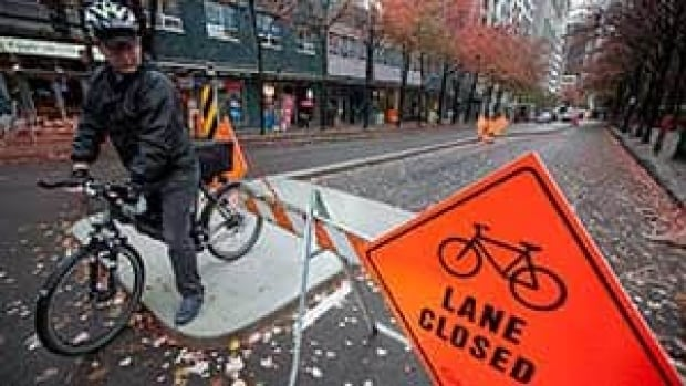 A cyclist tests out the newly built bike lane on Hornby Street in downtown Vancouver, in October 2010.