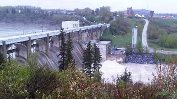 Officials loosened the valves at Calgary's Glenmore Dam to relieve pressure on the reservoir, increasing the flow to 160 cubic metres per second, three times the normal rate.