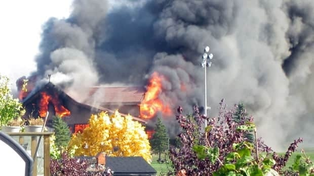 The Aspen Links Country Club in Emerald Park, Sask. is engulfed in flames on Sept. 28, 2011.