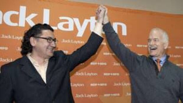 Romeo Saganash, left, raises hands with late NDP leader Jack Layton during a campaign rally in Quebec during the 2011 federal campaign. Saganash is running to succeed Layton as party leader.