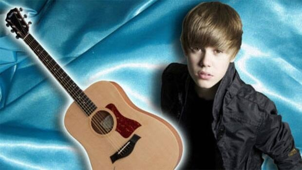 An autographed guitar from Justin Bieber is being auctioned off to raise money for Winnipeg Harvest food bank.