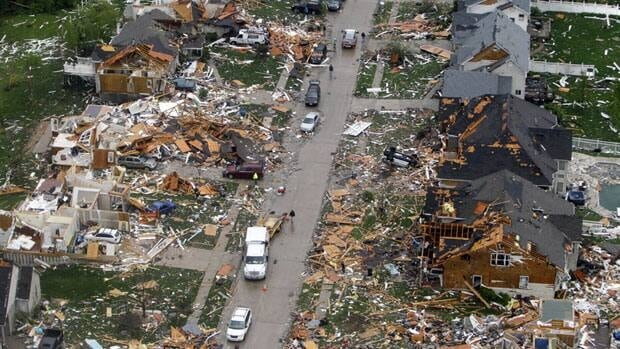 Debris litters the St. Louis suburb of Bridgeton after Friday's tornado. Officials said they were amazed that nobody was injured.