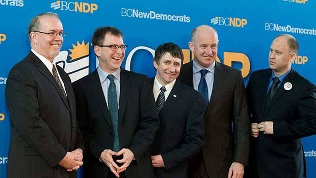British Columbia NDP leadership candidates John Horgan, from left, Adrian Dix, Nicolas Simons (who has since pulled out), Mike Farnworth and Dana Larsen pose for photographs together before a debate in Surrey, B.C., on Sunday March 20, 2011.