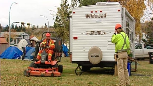 Workers prepare Whitehorse's tent and trailer city for winter.