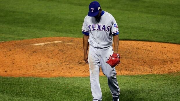 A dejected Neftali Feliz of the Texas Rangers walks off the mound at the end of the ninth inning during Game 6 of the World Series on Thursday night.