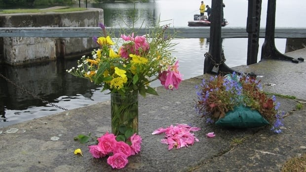 Flowers sit near the Kingston Mills locks on the Rideau Canal where the Shafia sisters and their father's first wife died on June 30, 2009. It has been suggested that the women's death was an honour killing.