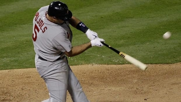 St. Louis Cardinals' Albert Pujols hits a two-run home run during the seventh inning of Game 3 of baseball's World Series against the Texas Rangers Saturday. Pujols would go on to hit a third home run and the Cardinals beat the Rangers 16-7.
