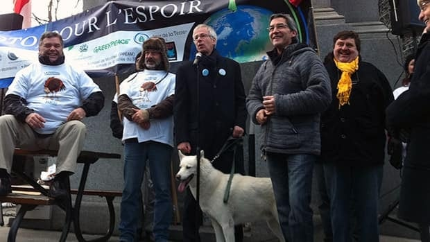 Former Liberal leader Stephane Dion and his dog, Kyoto, were amoung those gathered in Montreal Saturday.