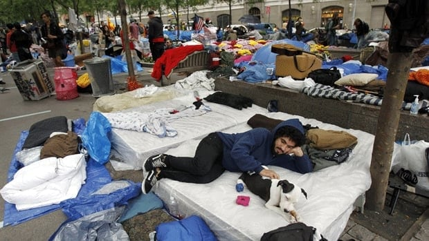 An Occupy Wall Street protester hangs out in Zuccotti Park in New York