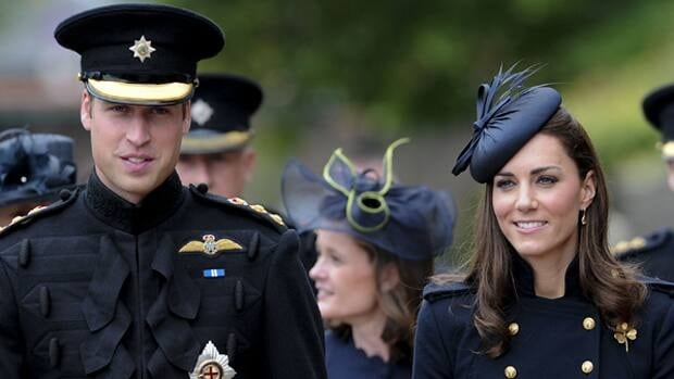 William and Kate walk through Victoria Barracks in Windsor, west of London, on June 25, to attend a medal parade for the 1st Battalion Irish Guards Regiment.