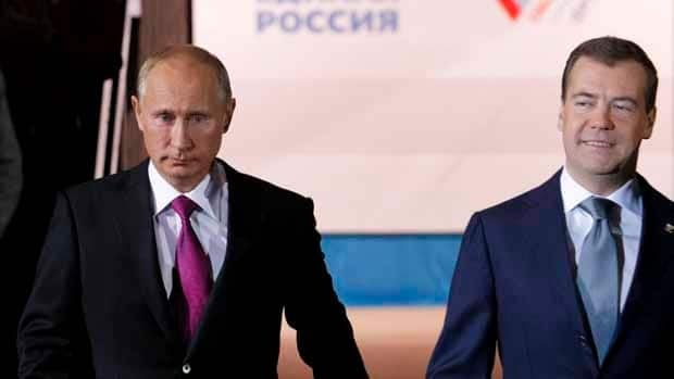 Russian President Dmitry Medvedev, right, and Prime Minister Vladimir Putin arrive to attend a United Russia party congress in Moscow on Saturday.