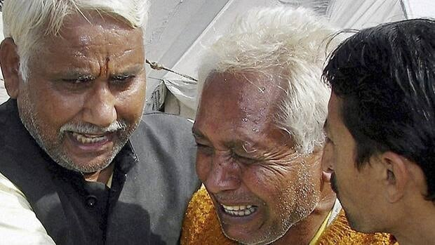 A victim's relative, centre, breaks down after a stampede on Tuesday during a religious ceremony on the banks of the Ganges River at Haridwar, 500 kilometres southwest of Lucknow, India.