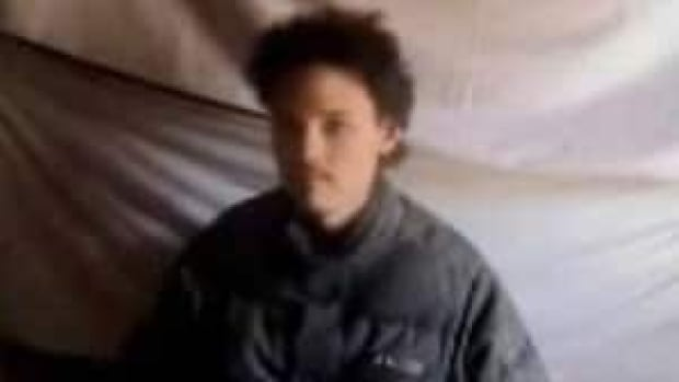 A still image from a video released by the Taliban in May 2011 shows Canadian Colin Rutherford in captivity. A journalist kidnapped by the Taliban in 2008 says Rutherford will always feel isolated by the experience.