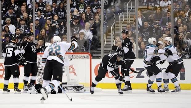 Kyle Wellwood (20) and Joe Thornton (19) of the San Jose Sharks celebrate a goal by Wellwood against the Los Angeles Kings in the second period of Game 6 in Los Angeles on Monday.