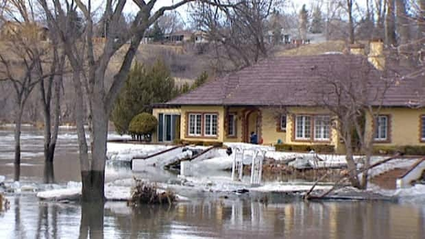 A home is threatened by the rising waters of the Moose Jaw River.