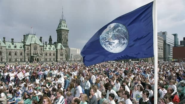 A crowd gathers on Parliament Hill to celebrate the 20th anniversary of Earth Day on April 22, 1990. The day is a good time to think about the resources we use and our impact on the environment.