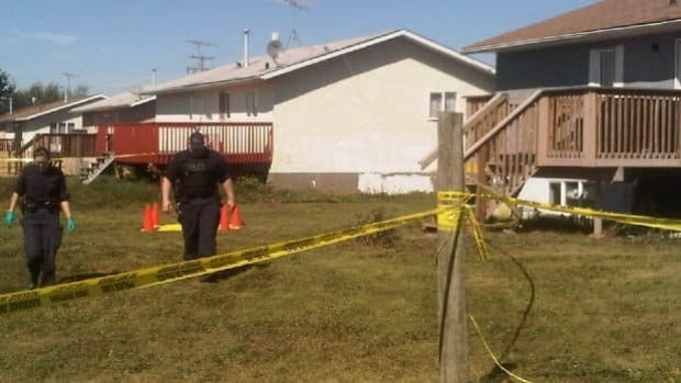 RCMP investigators search for evidence at Samson townsite following the shooting death of a woman early Monday.