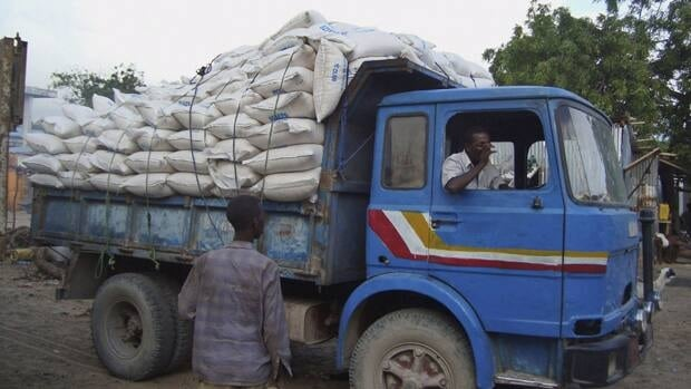 A truck delivers stolen food aid to a market at the former water agency in the Somali capital Mogadishu on Monday.