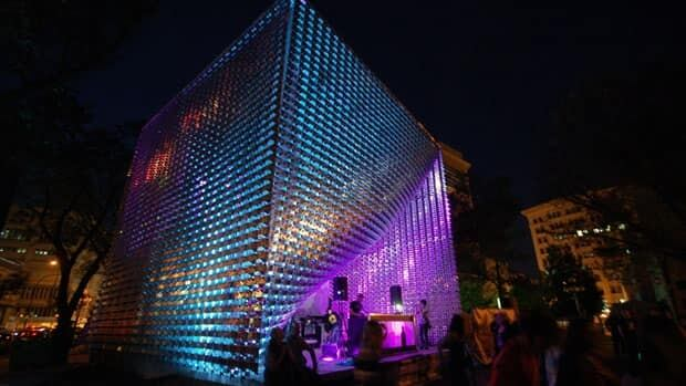 The Winnipeg Cube helps define an open-air performance space. The metal mesh pulls back to reveal the stage.