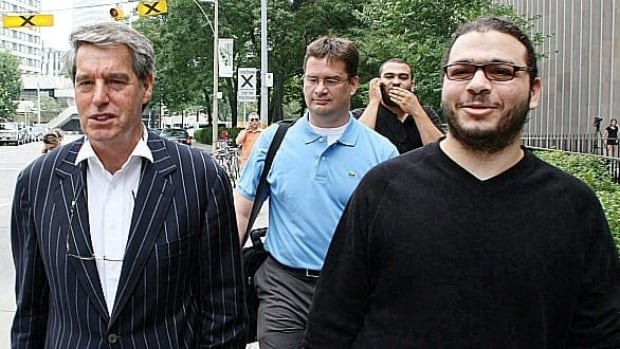 Abdullah Khadr, right, walks with his lawyers outside court in Toronto, on Aug.4, 2010. The Ontario Court of Appeal upheld a decision to stay extradition proceedings against the admitted al-Qaeda collaborator.