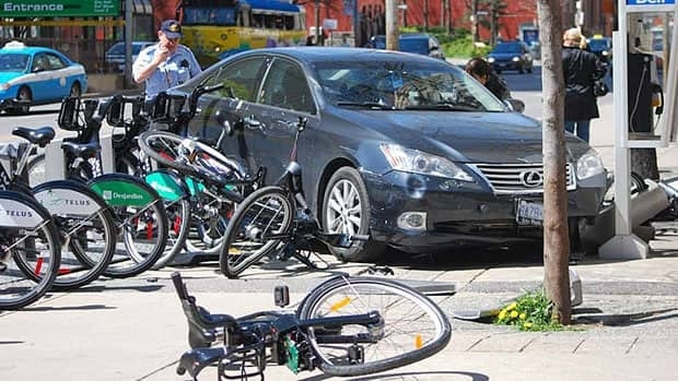 A car collided with a Bixi bike station on Bay Street Monday. Five bikes were damaged. (Submitted by Andrew Budziak)