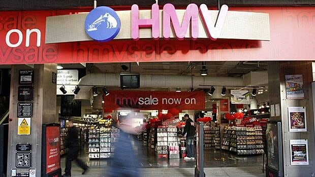 Shoppers walk past a branch of HMV in January. The Canadian division, which has 121 stores, was sold Monday.