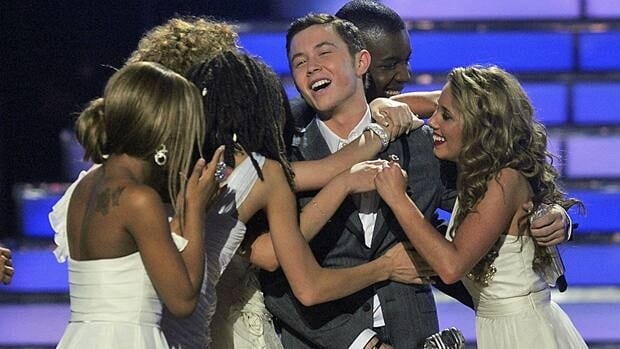 Scotty McCreery is congratulated by other contestants after winning the finale of American Idol in 2011.
