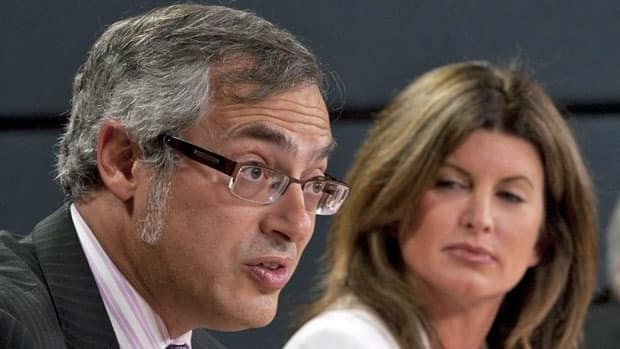 Public Works Minister Rona Ambrose listens to Treasury Board President Tony Clement as he responds to a question during a news conference in Ottawa Thursday. Ambrose and Clement announced a new agency to streamline IT services for the federal government.