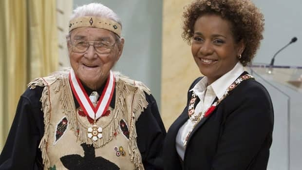 Former Governor General Michaelle Jean invests Elder William Commanda as an Officer of the Order of Canada.