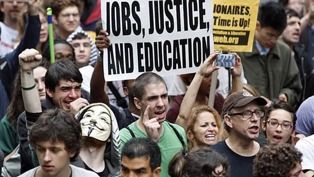 Occupy Wall Street protesters partake in a celebratory march on Friday after learning that they would not be evicted from New York City's Zuccotti Park temporarily for cleaning.