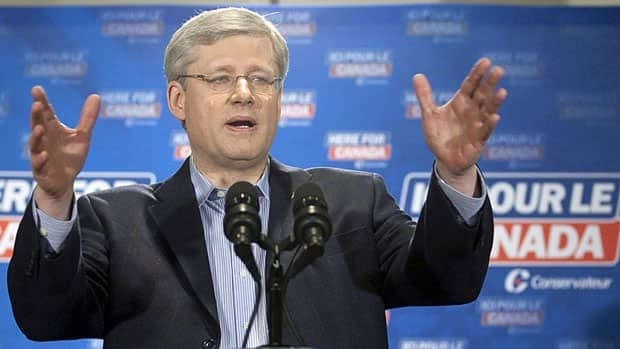 Conservative leader Stephen Harper gestures as he is questioned by reporters about coalitions following a campaign speech in Brampton, Ont., March 27, 2011.