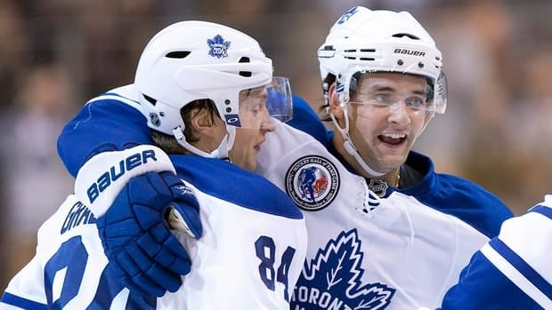 Toronto Maple Leafs Mikhail Grabovski, left, and Clarke MacArthur will both be absent from  the team's lineup after suffering injuries.