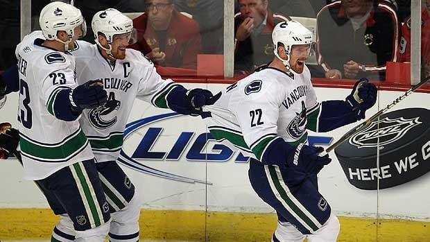 Daniel Sedin celebrates Vancouver's second goal during Game 3 in Chicago on Sunday.