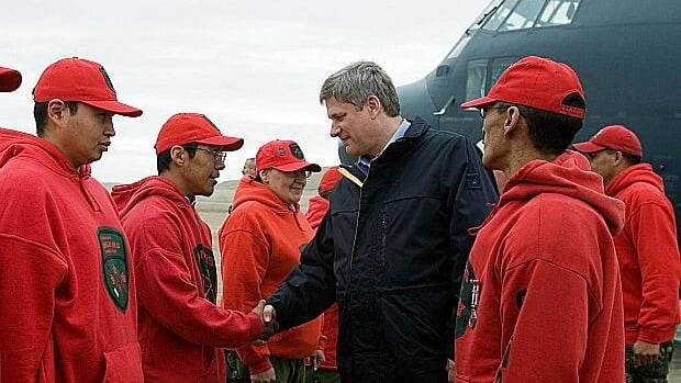 Prime Minister Stephen Harper is greeted by Arctic Rangers during his visit to Resolute Bay, Nunavut, in August 2007.