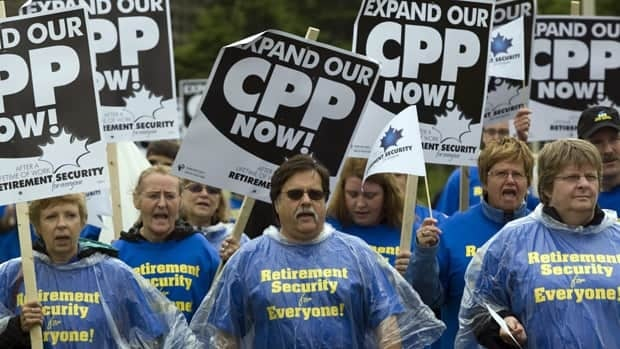 Members of several labour unions march to a meeting of federal, provincial and territorial finance ministers in Lakeside, P.E.I., on June 14, 2010, to demand higher CPP payouts.