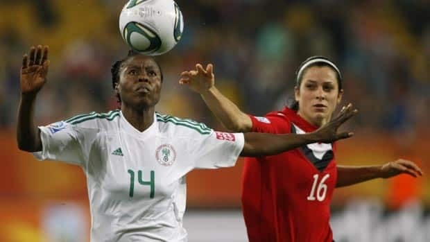 Nigeria's Faith Ikidi, left, and Canada's Jonelle Filigno, challenge for the ball during Tuesday's match.