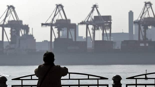 Container terminals in Tokyo: Japan has traditionally been closed to the idea of free- trade agreements.