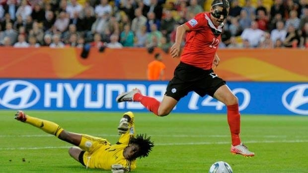 Canada's Christine Sinclair, right, kicks the ball past Nigerian goalkeeper Precious Dede but couldn't score during Group A action Tuesday in Dresden, Germany.