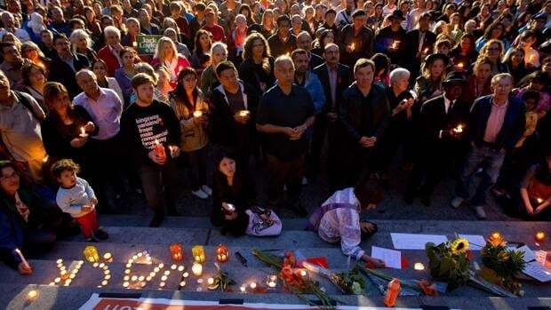 Hundreds of people gather for a candlelight vigil to remember late NDP leader Jack Layton in Vancouver, B.C., on Monday. Layton passed away early that morning in Toronto after a second battle with cancer.