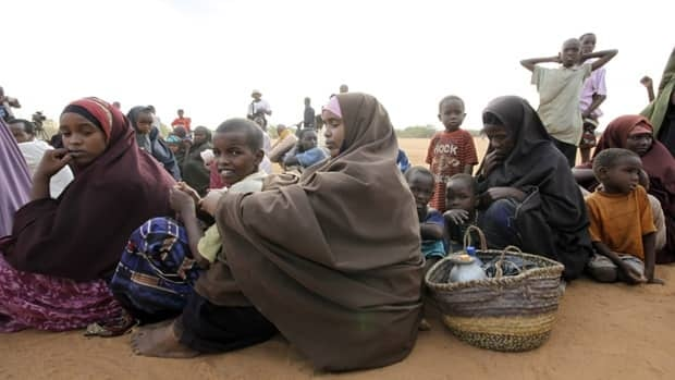 Women and children fleeing the war in Somalia queue to register at Dadaab, the refugee camp in northern Kenya in September 2010.