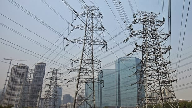 Transmission pylons in Beijing, shown on May 27, are part of the country-wide web of power lines that have helped turn China into the world's biggest energy consumer.