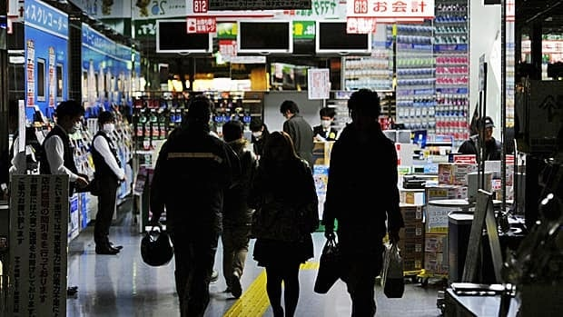 Consumers shop in near darkness in a Tokyo department store, its lights dimmed to conserve energy in the wake of the March 11 earthquake and tsunami. Energy use is down at least 15 per cent in an effort to avoid blackouts and power shortages. (Reuters/Kyodo)
