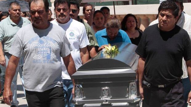 Family members carry the coffin of Petra Bustos, a victim of the Casino Royal arson attack, during her funeral in Santa Catalina, on the outskirts of Monterrey, Mexico, on Saturday.