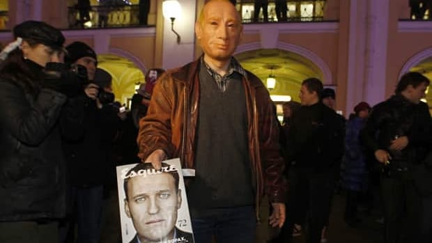 There's growing protests to Vladimir Putin's rule in Russia following widespread allegations of fraud in the Dec. 4 election. A protester in a Putin maskholds a copy of the current Russian edition of Esquire, which features Alexei Navalny, a leading Putin opponent and anti-corruption campaigner, at a protest in St. Petersburg on Dec. 8. The protester was later detained by police.