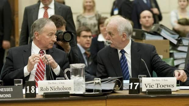 Justice Minister Rob Nicholson,left, and Public Safety Minister Vic Toews, shown at a committee meeting last spring, appeared at a committee on the omnibus crime bill on Thursday.